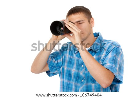 Handsome young man looking through a telescope isolated on a white background