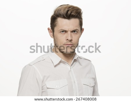 Handsome young man making furious face, isolated on white - stock photo