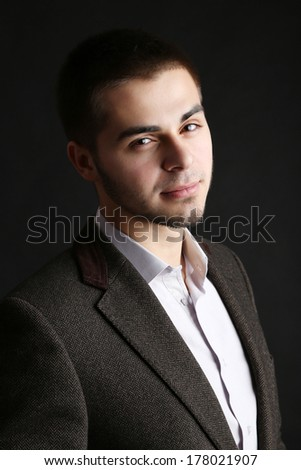 Handsome young man on dark background