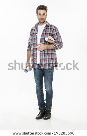 handsome young man on isolated background with blueprints in arm