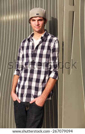 Handsome young man outdoor fashion portrait. - stock photo
