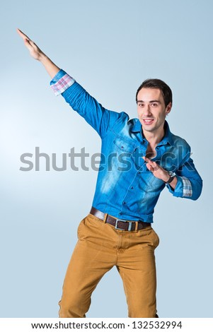 Handsome Young Man Over a Blue Background