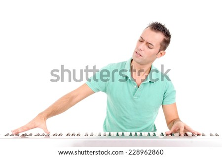 handsome young man playing the piano isolated in white background - stock photo
