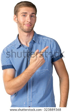 Handsome young man pointing copy space