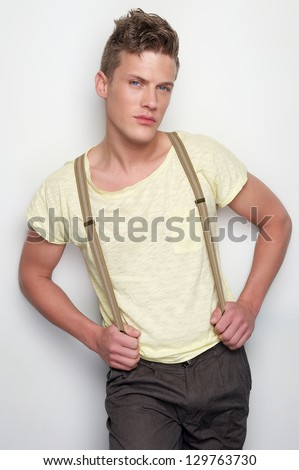 Handsome young man posing against white background - stock photo