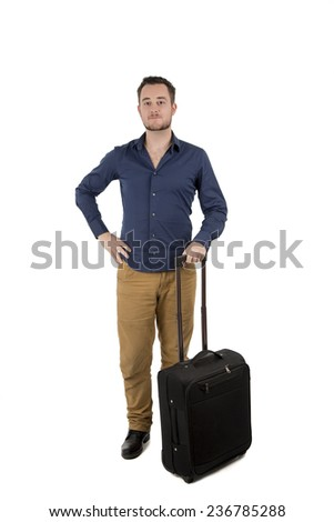 Handsome young man posing with a black suitcase against a white background - stock photo