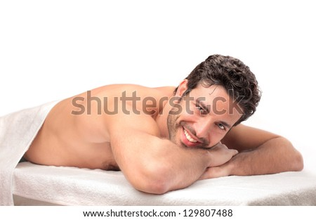 handsome young man relaxes - stock photo
