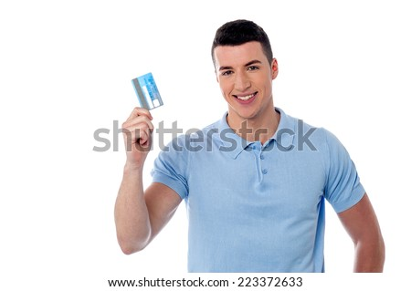 Handsome young man showing his credit card