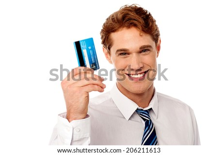 Handsome young man showing his debit card to camera