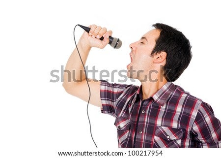 handsome young man singing to the microphone, isolated on white - stock photo