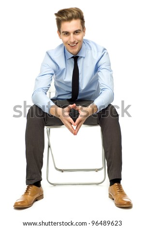 Handsome young man sitting - stock photo