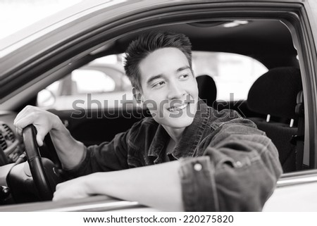Handsome young man sitting in the car - stock photo