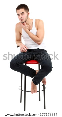 Handsome young man sitting on chair isolated on white