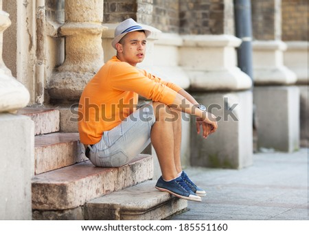 Handsome Young Man Sitting On Stairs Outdoor - stock photo
