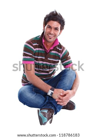 Handsome young man sitting on the floor, smiling to us
