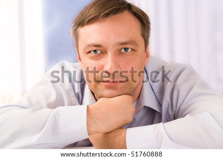 handsome young man sitting pensively