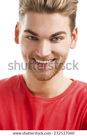 Handsome young man smiling and looking to the camera, isolated on white background - stock photo