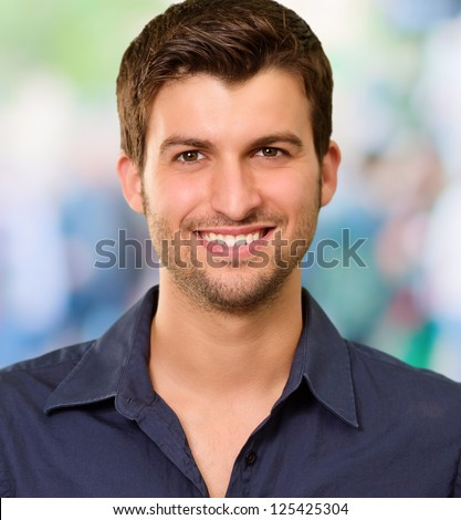 Handsome Young Man Smiling, Background - stock photo