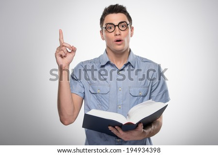 handsome young man standing and talking. attractive male opening book and teaching - stock photo