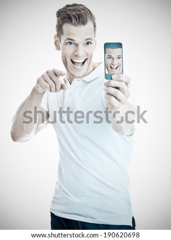 Handsome young man taking a selfie - stock photo