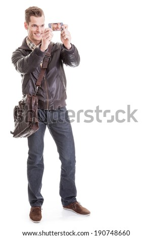 Handsome young man taking a selfie - Full length shot, isolated on white background - stock photo