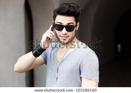 handsome young man talking on a smart phone