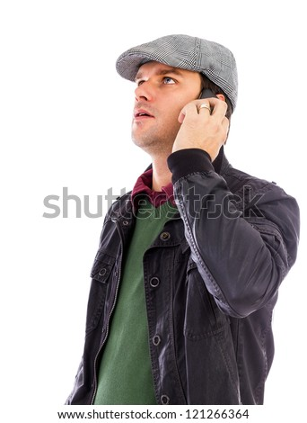 Handsome young man talking on phone isolated on white background