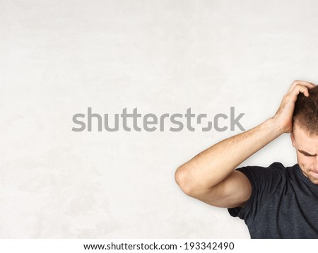 handsome young man thinking and confused and blank background, concept - stock photo