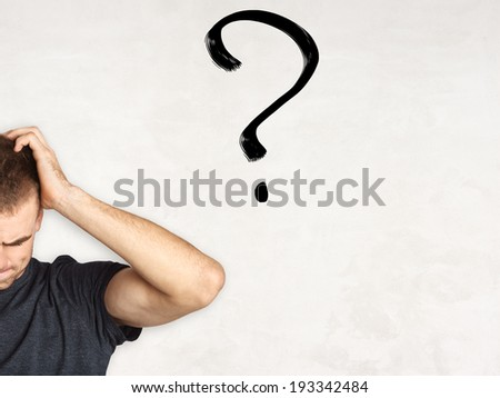 handsome young man thinking and confused, concept - stock photo