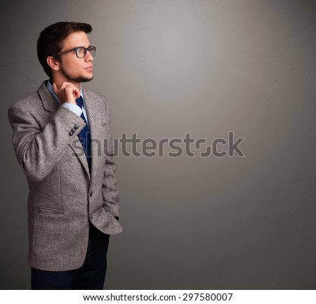 Handsome young man thinking with empty copy space