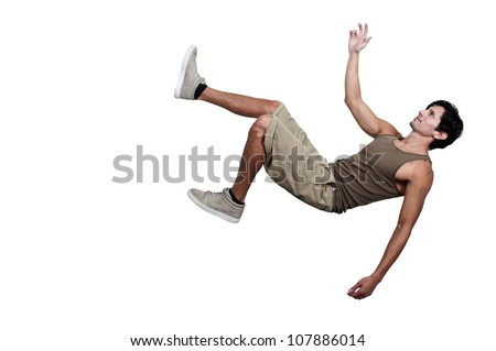 Handsome young man tripping slipping and falling - stock photo