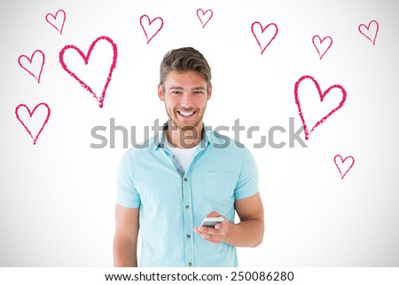 Handsome young man using his smartphone against white background with vignette - stock photo