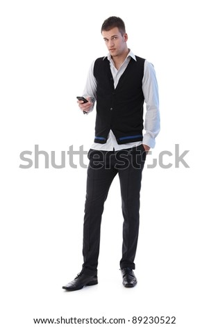 Handsome young man using mobile phone, writing text message.? - stock photo