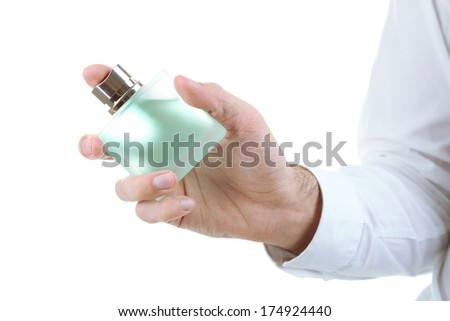 Handsome young man using perfume isolated on white - stock photo