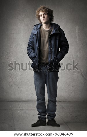 Handsome young man wearing a jacket - stock photo