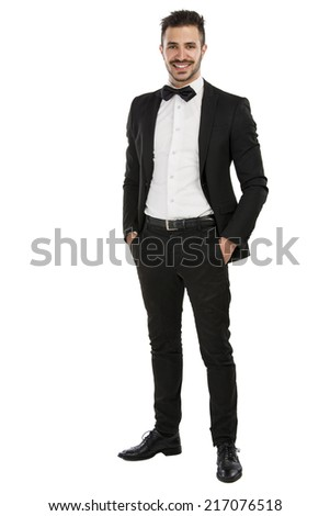 Handsome young man wearing a suit and smiling, isolated on white background - stock photo