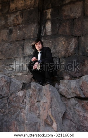 Handsome young man wearing a suit, outdoors fashion