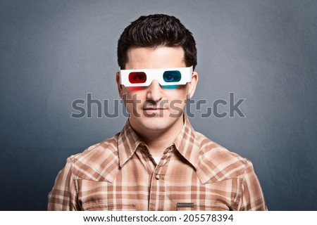 Handsome young man wearing 3D glasses - stock photo