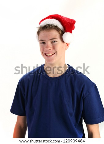 Handsome young man wearing santa hat for Christmas on white background - stock photo