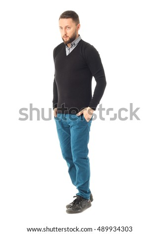 Handsome young man with a beard posing on white