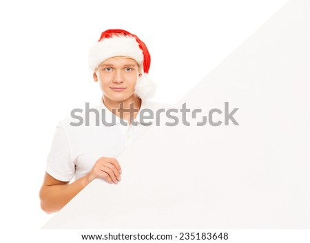 Handsome young man with a blank billboard isolated on white background - stock photo