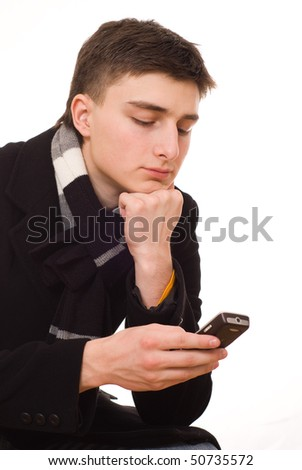 handsome young man with a phone on a white