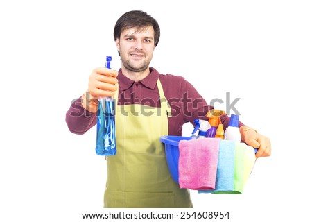 Handsome young man with apron holding a cleaning sprayer  ready to clean the house over white - stock photo