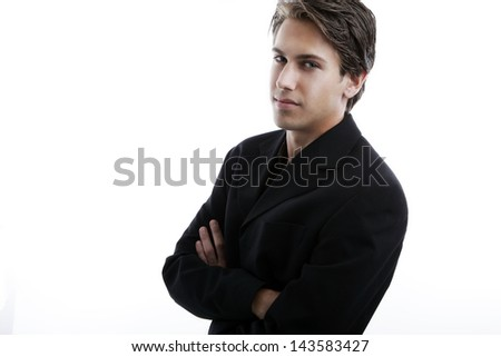 Handsome young man with attitude, arms crossed