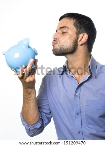 Handsome Young Man with Beard Kissing Piggy bank Isolated on White Background - stock photo