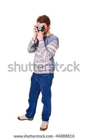 Handsome young man with camera isolated on white background