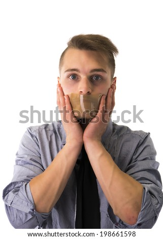 Handsome young man with duct tape on mouth cannot speak. Isolated on white - stock photo
