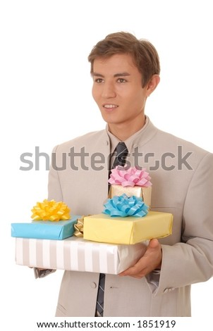 Handsome young man with gifts - stock photo