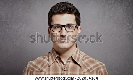 Handsome young man with glasses closeup with space for copy - stock photo
