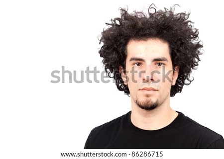 Handsome young man with goatee and long curly hair. - stock photo